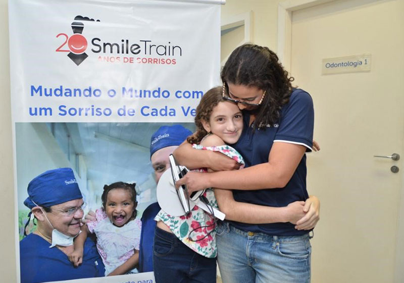 Camila hugs a Smile Train patient
